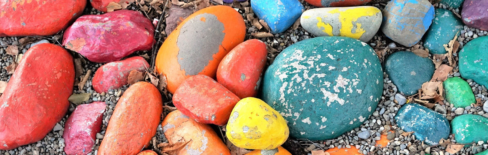 Brightly painted pebbles for colour and creativity